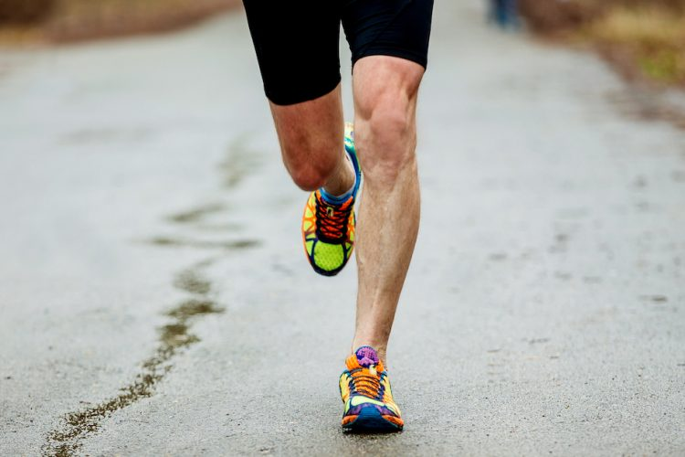 Man running with shin pain - shin splints