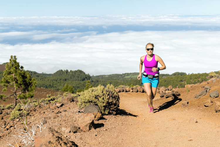 woman trail running